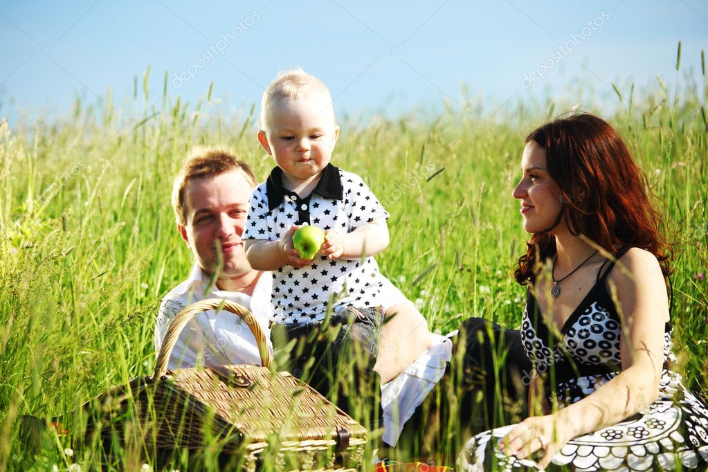  picnic of happy family on green grass  Stock Photo #7102232