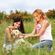 Girlfriends and dog — Stock Photo #7115399