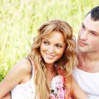 Stock Photo: Lovers on grass field