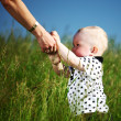 Boy and mother hands — Stockfoto