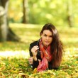 Woman portret in autumn leaf — Stock Photo