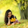 Woman portret in autumn leaf — Stock Photo #7192915