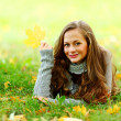 Woman portret in autumn leaf — Stock Photo #7192975