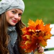 Woman portret in autumn leaf — Stock Photo #7193023