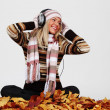 Autumn woman listening music