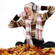 Stock Photo: Autumn woman listening music