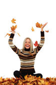 Woman drop autumn leaves in studio — Stock Photo