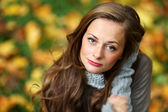 Woman portret in autumn leaf — Stok fotoğraf