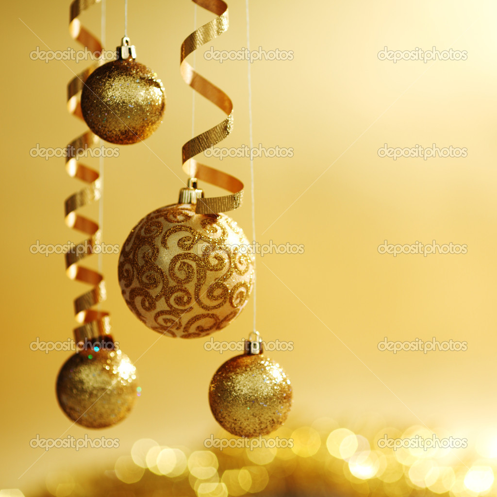 Golden christmas balls on bokeh background — Stock Photo #7192819