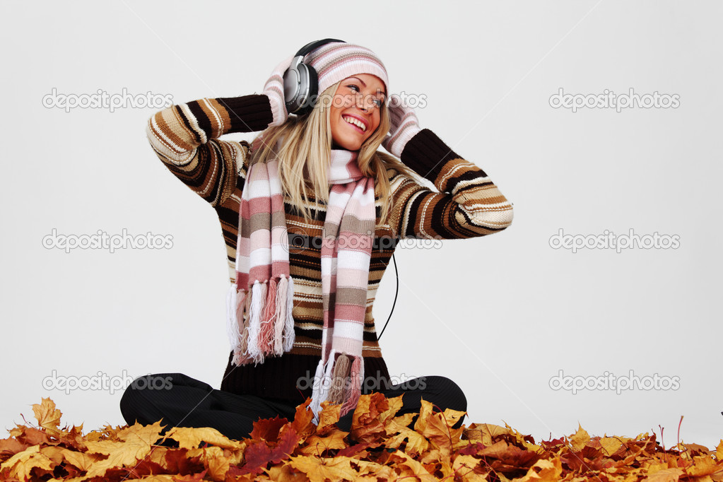 Autumn woman listening music in studio — Stock Photo #7193065