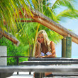 Woman in a tropical cafe — Stock Photo #7203504