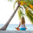 Yoga woman under palm — Stock Photo #7203697