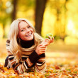 Woman eat apple in autumn park — Stock Photo