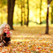 Woman eat apple in autumn park — Stock Photo #7257870
