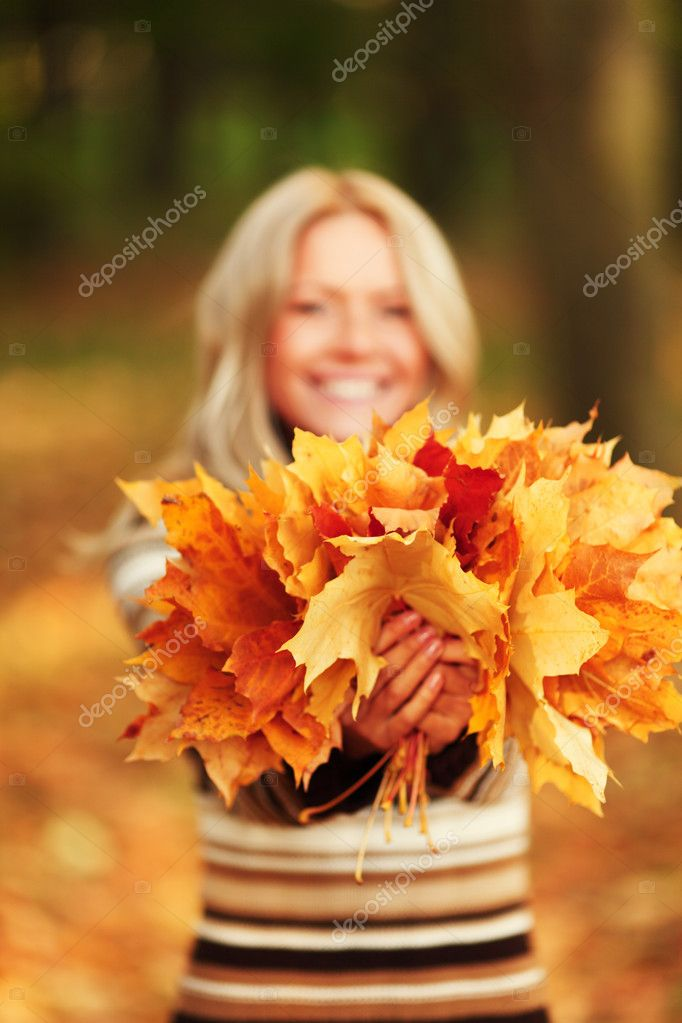 Woman on leafs in autumn park  Stock Photo #7257892