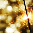 Sparkler on bokeh background — Stock Photo #7276048
