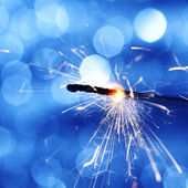 Sparkler on bokeh background — 图库照片