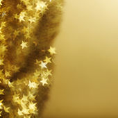 Golden star bokeh background — Stock Photo