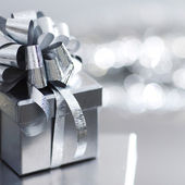 Silver christmas gift — Stock Photo