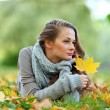 Woman portret in autumn leaf — Stock Photo #7294427