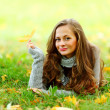 Woman portret in autumn leaf — Stock Photo #7294434