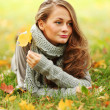 Woman portret in autumn leaf — Stock Photo #7294445