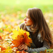 Woman portret in autumn leaf — Stock Photo #7294449
