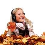 Autumn woman listening music — Stock Photo #7294554