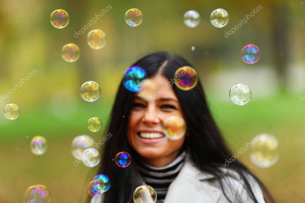 Autumn woman blow bubbles portrait in park — Stockfoto #7294030