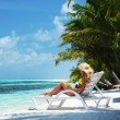 Tropical woman on lounge — Stock Photo #7331994