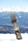 Snowboard on mountains — Stock Photo