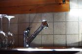 Kitchen sink glass — Stock Photo