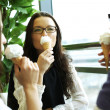 Happy women licking ice cream — Stock Photo #7472159