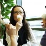 Happy women licking ice cream — Stock Photo
