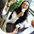 Women licking ice cream — Stock Photo