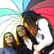 Girlfriends under umbrella — Stock Photo