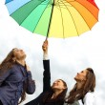 Girlfriends under umbrella — Stock Photo #7472404