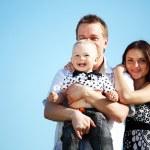Happy family in sky — Stock Photo
