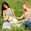 Girlfriends and dog — Stockfoto #7473368
