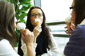 Happy women licking ice cream — Stock Photo