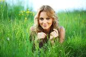 Woman on the grass — Zdjęcie stockowe