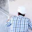 Worker aligns wall — Stock Photo #7534852