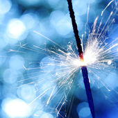 Sparkler on bokeh background — Photo