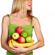 Woman holds a pile of fruit — Stock Photo #7621172