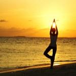 Sunset yoga woman — Stock Photo