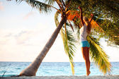 Yoga woman under palm — Stock Photo