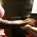 Woman playing piano — Stock Photo #7685009