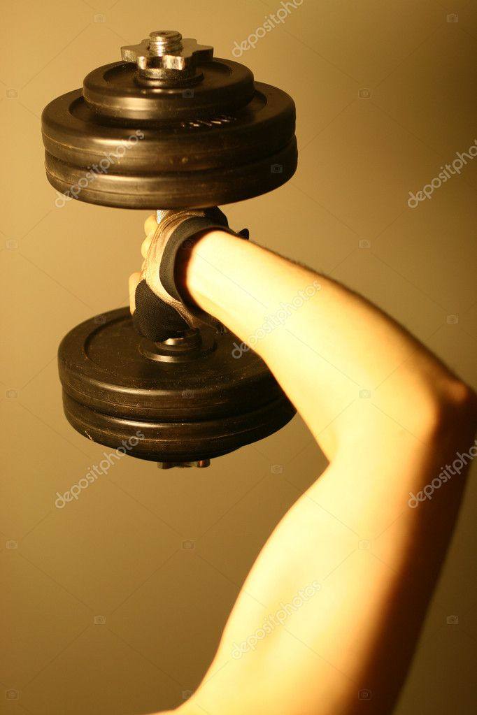 Dumbbell in strong hand — Stock Photo #7685089