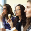 Happy women licking ice cream — Stock Photo #7743150