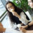 Happy women licking ice cream — Stock Photo #7743156